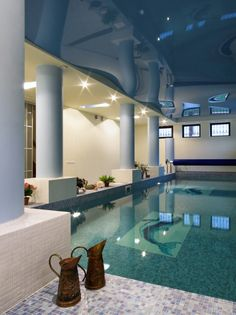 Roman style indoor swimming #pool with columns and marble floor