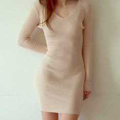 d r e s s 👑Boss Lady Dress👑 in Beige.  🔹NEW without tags- only tried on once for the picture 🔹Super soft, v-neck, long sleeves, hugs curves in the right places👌🏼 🔹Material: Ribbed knit— polyester & cotton. Stretchy and thick fabric- you'll love the feel of this bodycon dress!!! 😍 🔹Only have 1 in stock in this color / Dresses