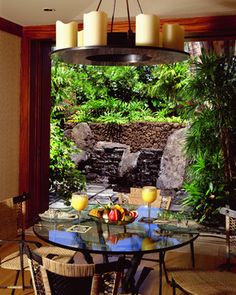 The breakfast room opens to a meditation garden with a lava water feature which creates the effect of floating stones.