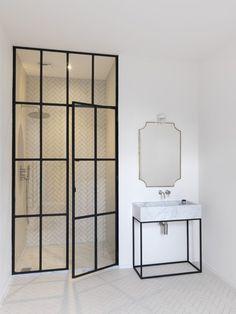 Luxury master bathroom by Studio Maclean West London with steel-framed shower door. Chris Tubbs photo.