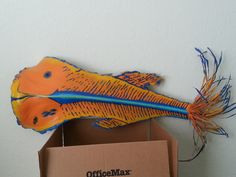 Fish painted palm frond