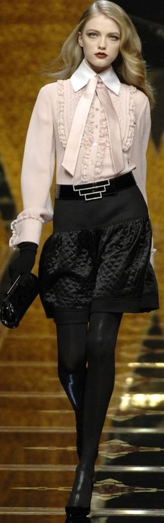 Valentino blush blouse, quilted black skirt, tights.