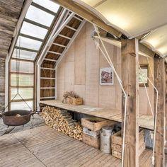 Really cool barn conversion. I love the wrap around window.
