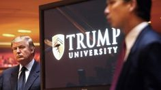 Trump University slammed by NY AG.  In this May 23, 2005, file photo, real estate mogul and Reality TV star Donald Trump, left, listens as Michael Sexton introduces him at a news conference in New York where he announced the establishment of Trump University.