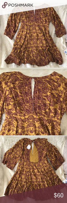 New! Ecoté Dress from UO! Never been worn, tag still attached! Completely brand new dress with floral design. Front has a slit opening as well as the back. Very cute! Ecote Dresses Midi