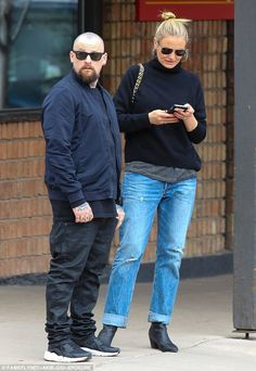 Casual couple: Cameron Diaz and husband Benji Madden looked the epitome of chilled-out as ...