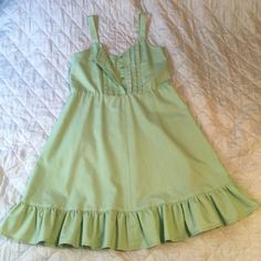 """Medium Length Sun Dress Handmade pastel green sun dress. Button down front and the 1"""" wide straps are adjustable length with buttons. The dress is around a misses size 14 or 16 and the length from the top of the shoulder strap to the bottom of the dress is 38"""" with the last 4-3/4"""" being ruffles. Very good quality workmanship. Open to offers. I also offer 10% discount on bundles of 2 or more items. Handmade Dresses Midi"""