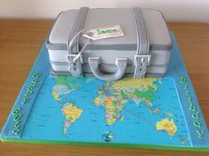 60th birthday suitcase cake for a lady that loves to travel..Vanilla sponge covered in buttercream and sugarpaste.. The map is an icing sheet depicting her planned route of travel..