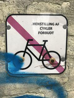 Sign on wall next to street in Copenhagen