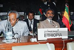 Haile Selassie (R), originally Prince Ras Tafari Makonnen (1891-1975) the Emperor of Ethiopia (1930-6, 1941-74) poses for the photographer in September 1973 at the opening session of a nonaligned summit in Algiers. Haile Selassie led the revolution in 1916 against Lij Yasu, and became regent and heir to the throne, westernizing the institutions of Ethiopia. In the early 1960s he helped to establish the Organization of African Unity (OAU) and the Movement of Nonaligned Countries. /