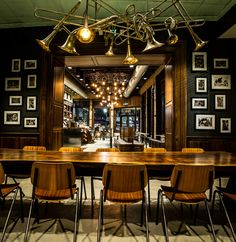 The Starbucks store at the heart of New Orleans on Canal Street includes light fixtures inspired by musical instruments and a 12-foot community table made with wood repurposed from wind fallen trees.
