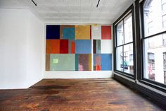 Donald Judd's Soho Loft - A work by David Novros dominates one wall, unobstructed for pure seeing, as just about every item in Judd's space is.