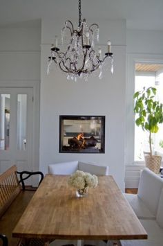 In-wall fireplace between the kitchen and dining rooms? Yes, please.