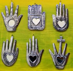 """Lil mexican mirrors """"A closed fist is always empty. Mexican Design, Mexican Style, Mexican Folk Art, Objets Antiques, Tin Art, Hand Of Fatima, Heart Art, Sacred Heart, Religious Art"""
