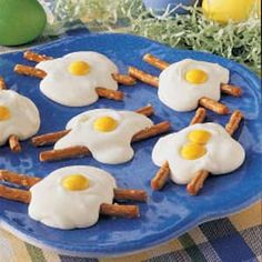 """Fried Egg Candy!   Pretzels are the """"bacon"""", melted white chocolate is the white part of the """"egg"""" & yellow m&m's are the """"yolk""""!"""
