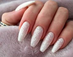 White And Silver Glitter Nails Long Coffin Nails This is one of the golden combinations that you ought to try out. For long coffin nails, the effect created by the silver glitter is cooler on both shiny white and matte white. Sparkly Acrylic Nails, Silver Glitter Nails, Coffin Nails Matte, Diamond Glitter, White Sparkle Nails, White And Silver Nails, Matte White Nails, Acrylic Nails Coffin Ballerinas, Glitter Acrylics