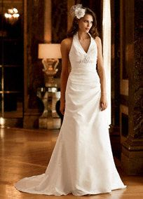Dramatic neckline and an elegantly draped bodice combine to create a beautifully flattering bridal gown.   Taffeta high-collar halter is flattering and fashion-forward.  Side-draped trumpet gownfeatures stunningbeading and button back detail.  Chapel train.  Available online in Ivory and White.  To preserve your wedding dreams, try our Wedding Gown Preservation Kit.