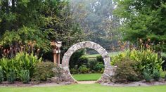 Garden - Rustic Backyard Designs To Beautify Backyard Area Of House With Arc Shape Entrance Gateway Made Of Stone: Awesome Backyard Designs Ideas for Relaxing Living Space Concept