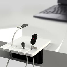 """The Finger Jack Holder is a great idea that helps you keep your cables organized on your desk. The fingers keep your cables ordered and within reach. The option of tagging each cable is quite a clever one, it makes it easier for you to pick the camera charger line out of the other gadget and devices cable that the fingers hold."""