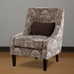 Add extra seating and a touch of elegance to any office space or living area with this stylish living room chair. The espresso finish and graceful pattern in shades of brown, gray, and cream will blend with any look.