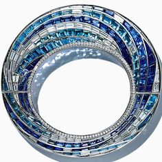 Tiffany & Co. Prism Wave Bracelet in platinum with sparkling rows of sapphires, aquamarines and diamonds. Z