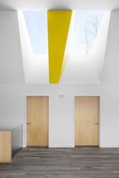 This house features two skylights separated with a bright yellow partition.