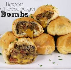 Bacon Cheeseburger Bombs-1 pound lean ground beef  1/2 onion, finely chopped  3 slices of bacon, chopped  1/3 cup cream cheese  1 tablespoon ketchup  2 tablespoons barbecue sauce  1 teaspoon yellow mustard  1 teaspoon of Worcestershire sauce  1 egg white  1 can Pillsbury Biscuits (10 biscuits)  5 oz cheddar cheese, chopped into 10 squares #food #yummy #delicious