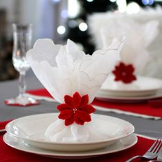 Free crochet pattern and tutorial to make a poinsettia napkin ring for the Christmas table setting.