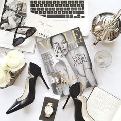 Photo styling - black & white flat lay with laptop, heels and Vogue.