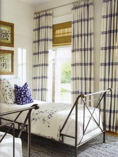 Love the campaign beds. Striped window treatments are great pared w matchstick blinds.