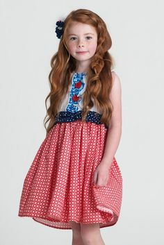 MAGGIE DRESS (S16) 200-S16-RED-02 RV $84 The Maggie is oh so sweet with a white floral embroidered bodice adorned with ruffles and big red buttons. Her skirt has a retro geometric checked pattern is a super soft cotton fabric. Perfect for any parade or summer BBQ!   She buttons down the back Hits at the knee Made of cotton Handmade with love right here in Utah in the USA!