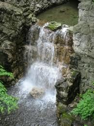 I love the sound of water trickling! I would love to have a backyard waterfall!