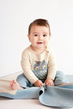 It's a lucky baby that receives designer Leslie Pitts' cotton cashmere one-piece and blanket. For fall 2014, Pitts colored the deliciously soft pieces in serene shades of cream, gray and pale blue for a timeless take on a trendy motif. www.luckyjadeproducts.com (editor's pick)