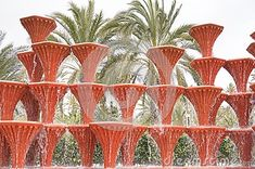 Red fountain in the park of Elche, Spain. El Palmeral