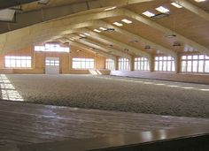 Westview Farms in Pawling, NY (above) - the 100'x200' steel-framed arena has a fully-finished interior, with walls and ceiling covered in tongue & groove pine. The pine has been given a light honey stain and poly-coated; the steel columns and trusses have been painted in a color to blend with the wood. With large, operating windows and skylights, the arena is flooded with natural light and cross ventilation.