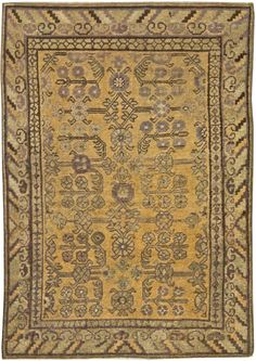 "A Samarkand Rug Size:5'5"" x 3'9"" Circa:1920 An early 20th century Samarkand rug, with a trellis overall of angular vinery and abstract flowerheads within striped and key pattern borders. Price: $15,000"