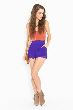 scalloped hem - huge trend this season. love the bold colour combo too!