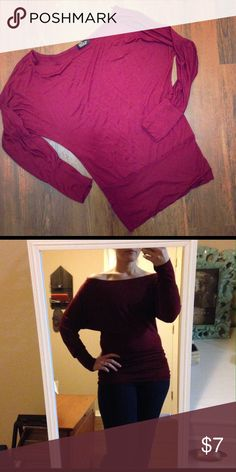 Buzy off the shoulder top This is a beautiful and romantic wine colored off the shoulder shirt! It has a loose dolman style sleeve and is longer and tight around the waist. Excellent condition never been worn! Thanks for looking! Buzy Tops