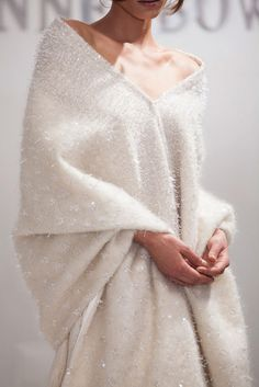 The Anne Bowen oversized bridal shawl is perfect to keep you warm on a cold wedding day.