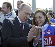 Putin looking at an iPhone. Look at Putin holding that iPhone. | 48 Photos Of Vladimir Putin Looking At Things