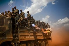 A truck filled with soldiers of the Sudan People's Liberation Army (SPLA), the military force of South Sudan, rushes toward the front line in mid-April. They are headed for the outskirts of Heglig, a disputed town they took briefly from the northern regime of Sudan, which is ruled from Khartoum. South Sudan declared independence from Khartoum in July 2011.