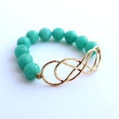 Infinity Bracelet   $38   Features natural gemstones and highlighted by an infinity-inspired bronze charm. Handmade in Charlotte, NC by women overcoming poverty & injustice. #fairtrade #infinitybracelet #seagreen