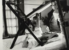 Frida Kahlo, painting in bed after an accident