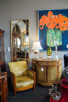 Need a pop of color in an otherwise neutral room? Add a piece of original artwork - a great conversation starter! Painting and armchair found at Avery Lane in Scottsdale, Arizona