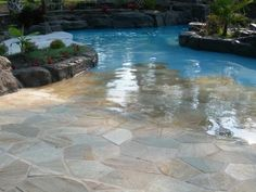 Walk-in pool with stone floor