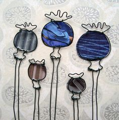 Handmade wire drawing of poppy seed heads by HelenSlomanDesigns, £28.00