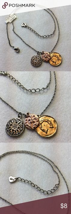 "AEO Silver Adj. Necklace with a Triple Medallion American Eagle Outfitters adjustable necklace with 3 medallions.  Can be worn anywhere between 18.5"" & 20.5"".  Tri-tone focals - Golden Horseshoe, copper flower and silver filigree.  Thanks for looking today. American Eagle Outfitters Jewelry Necklaces"
