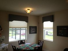 "18"" Custom Cornice Boards covering motorized cell shades. Available at Budget Blinds"