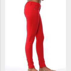 Bright red skinny jeans Bright red skinny jeans. This item is pre-owned, but are in great condition - no holes, stains, or rips. Pair with a neutral color top to complete the outfit. They are a size 9/10 (tag says) and have a lot of stretch to them. Price firm Rue 21 Jeans Skinny