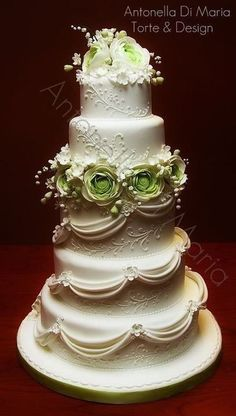 Beautiful white cake with green roses